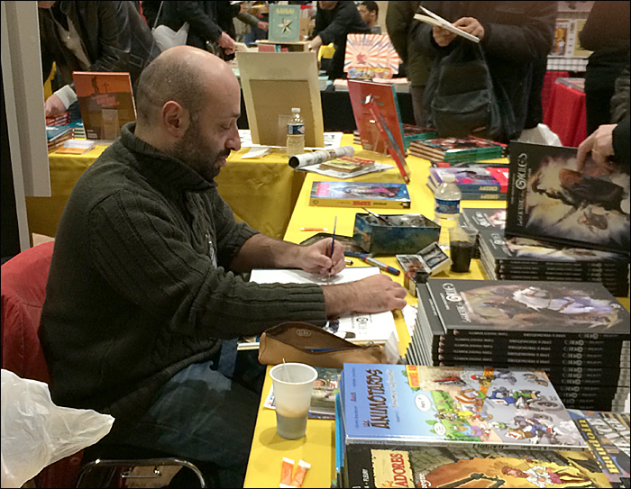 Vincent Pompetti watercolouring his signing; pic: Steve Sampson