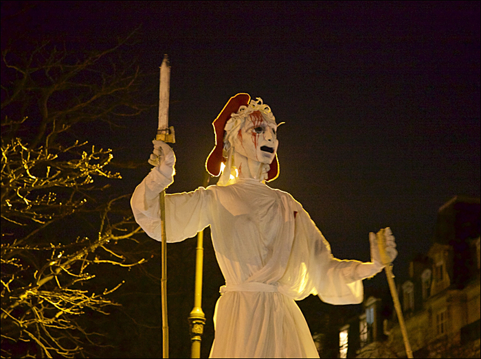 The giant puppet of Marianne, with a black armband, at the end of the path; pic:Steve Sampson